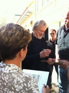 Kristofferson signing autographs